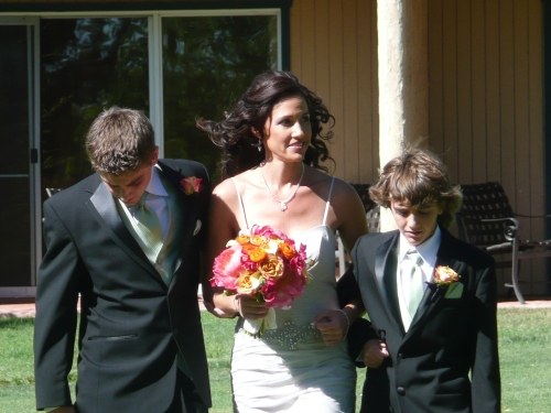 Our lovely bride Tracy walking to the ceremony site with her sons Dominic and Noah