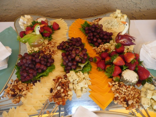Chef Felipe's colorful fruit and cheese display with hand carved bird decorations