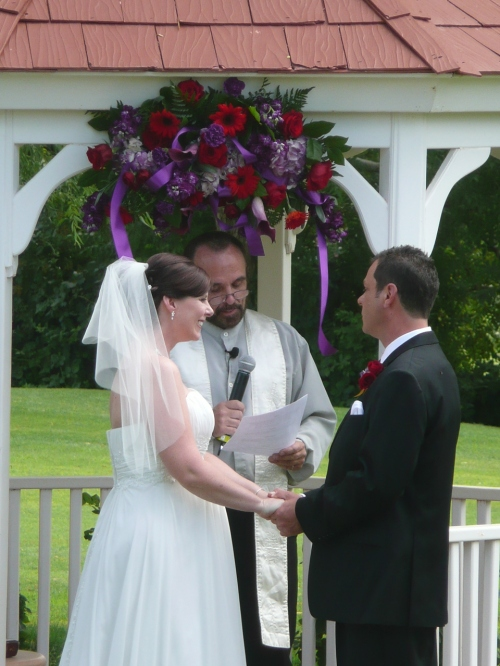 Heather and Ryan exchanging wedding vows.