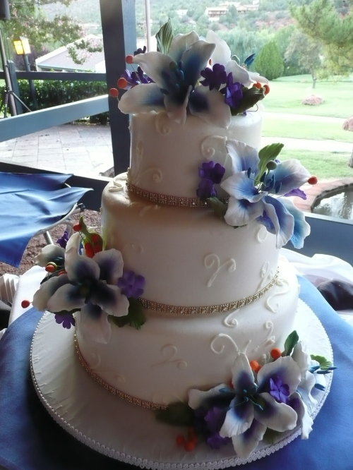 The beautiful wedding cake created by Donna Joy, adorned with hand made sugar flowers.