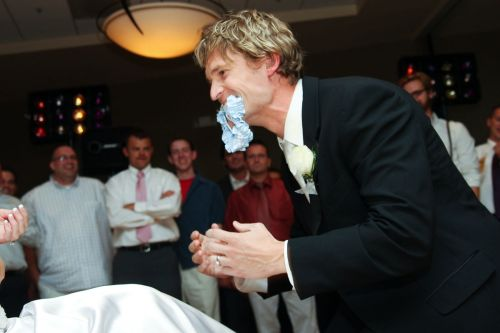 A Fun Way of Obtaining the Wedding Garter - Photo by Brides for Brides Photography