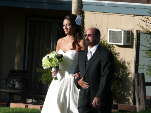Lovely Lisa walking down the aisle with her father Richard
