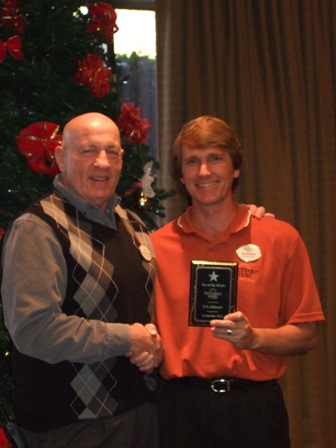 Poco Diablo General Manager Michael Steinhart presenting the Employee of the Month Award to Eric Johnson, Banquet Captain