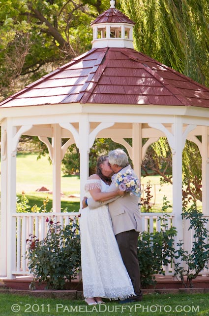The lovely bridal couple Taye and Ron in front of the Golf Course Gazebo
