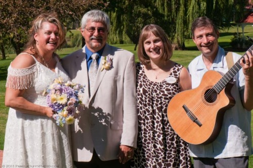 Bridal Couple Taye and Ron Miget with Jill Kyriakopulos, Catering Sales Manager and Guitarist Brian David
