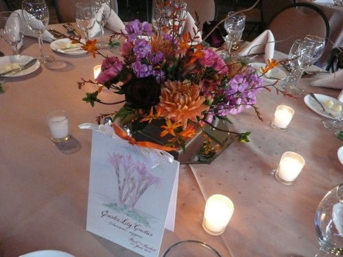 Guest Tables Adorned by Floral Centerpieces by Bliss Floral. Hand Painted Table markers were made for the event.