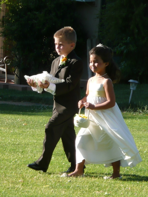 The adorable flower girl and ring bearer
