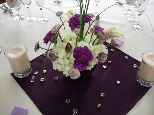 Lovely floral centerpieces included the color theme of the wedding