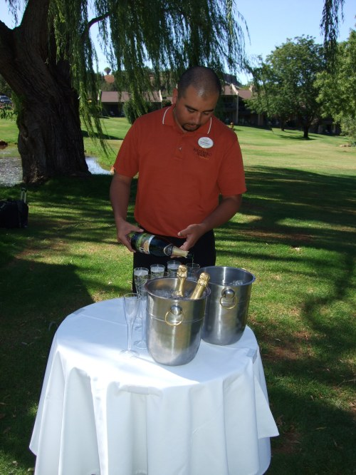 Javier preparing to serve the champagne