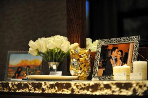 Personal photos accompanied by lovely flowers on display at the reception.