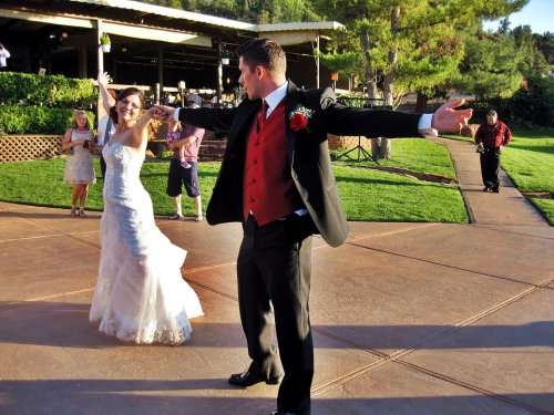 Bride and Groom Dancing on the Rose Terrace - Sierra Blanco Photography