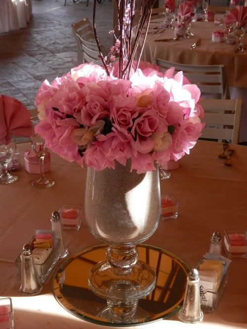 Beautiful floral centerpieces adorn the wedding reception