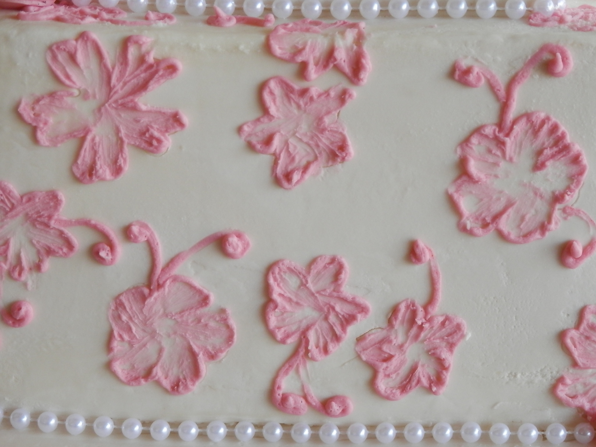 Hand Made Butter Cream Floral Scroll Design on the Square Butter Cream Cake