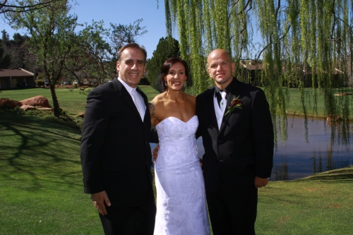 The bridal couple with officiant Ken Froessel - Photo by Janise Witt