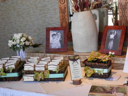 Welcome Table for Guests with Family Wedding Photographs
