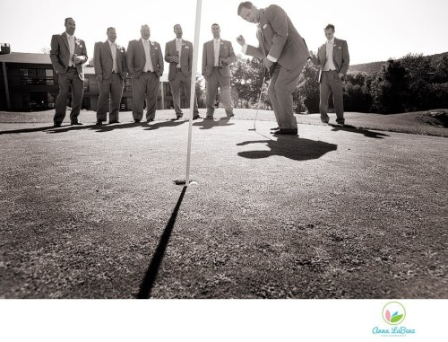 Our groom Matt winning at Golf the day - Photo by Anna LaBenz Photography