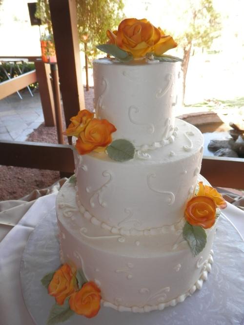 The elegant wedding cake was created by Donna Joy, Sedona Sweet Arts.