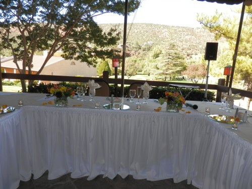 The Head Table Decorated with Beautiful Floral Arrangements