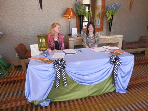 Lori (left) and Hollie at the registration table.