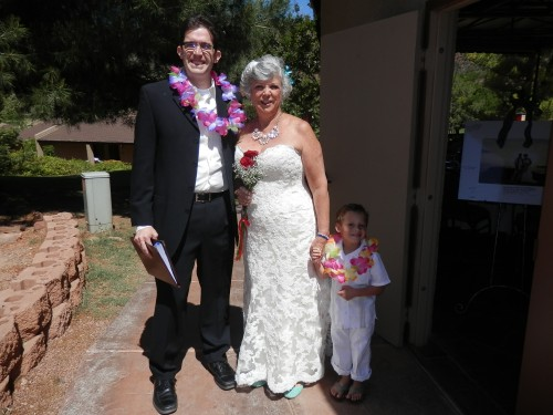 Bride Maggie with her grandson and her officiant.