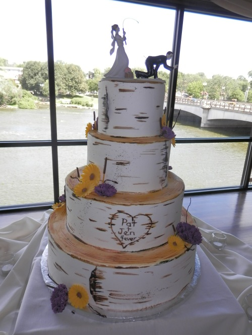Loved the Topper on Jennifer and Patrick's Wedding Cake