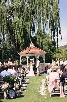 Wedding Ceremony at the Golf Course Gazebo - Photo by Natalie Miller