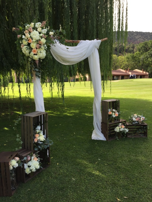 Lovely Arch created by Mountain High Flowers for Carley and Ryan's September 10th Wedding